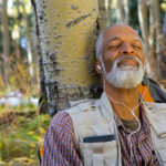 man_relaxing_in_woods